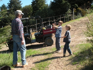 Larry working in Vineyard with his grandchildren